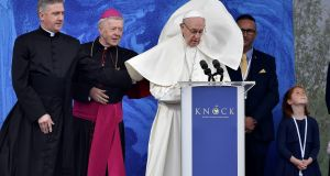 A gust of wind catches Pope Francis's cassock as he addresses crowds at Knock Shrine in Co Mayo at the weekend. Photograph: Charles McQuillan/Getty Images