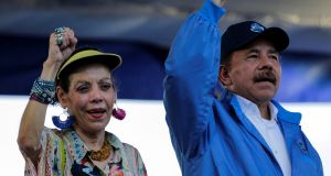 Nicaraguan president Daniel Ortega (right) and vice-president Rosario Murillo: deny government responsibility for the turmoil. Photograph: Oswaldo Rivas/Reuters