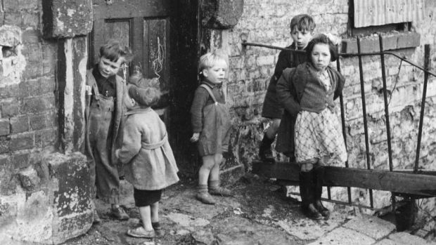 Children in the slums of Cumberland Street in the 1940s: Shaw as an economist understood better than most capitalists how an economy works but also believed an economy should not be producing luxuries until social necessities have been taken care of. Photograph: Paul Popper/Popperfoto/Getty