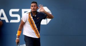 Nick Kyrgios puts his hand up to his ear to encourage the cheering crowd before closing out his win in his second-round match with Pierre-Hugues Herbert during the US Open in New York. Photo: Rick Loomis/The New York Times