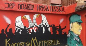 "A mural in the Serb district of Mitrovica, an ethnically divided town in northern Kosovo, reads: ""There's no going back from here. Kosovska Mitrovica."""
