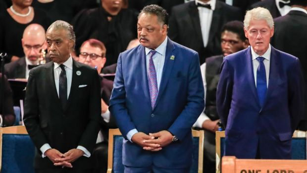 The Rev Al Sharpton, the Rev Jesse Jackson and former US president Bill Clinton stand together before the start of Aretha Franklin's funeral in Detroit, Michigan. Photograph: Tannen Maury/EPA
