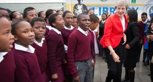 Theresa May dancing in Cape Town. Photograph: Stefan Rousseau/PA