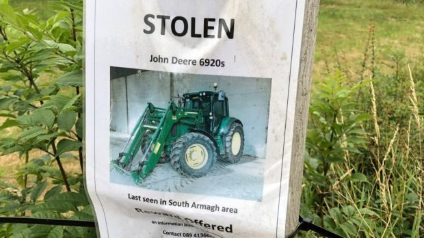 On the road into Castleblayney in Co Monaghan, a poster of a stolen John Deere tractor offers a reward for information about its disappearance. Photograph: Frank McNally