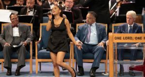 Singer Ariana Grande performs at the funeral for Aretha Franklin at the Greater Grace Temple in Detroit. Photograph:  Scott Olson/Getty Images