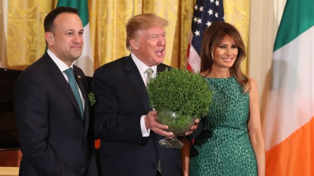 Taoiseach Leo Varadkar presents Donald Trump with a bowl of shamrock as Melania Trump looks on during the annual presentation ceremony at the White House in Washington DC. Photograph: Niall Carson/PA Wire