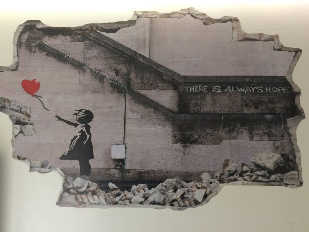 Electric Picnic 2018: A Banksy print in a gents' loo. A wee bit philosophical. Photograph: Tony Clayton-Lea