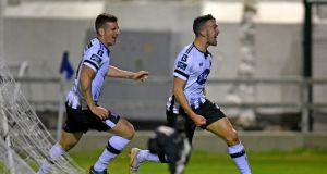Dundalk's Michael Duffy celebrates scoring their first goal with Patrick McEleney. Photo: Ciaran Culligan/Inpho