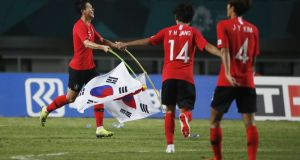 Son Heung-min celebrates after South Korea secured gold in the Asian Games. Photograph: Darren Whiteside/Reuters