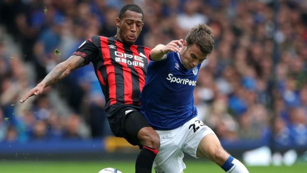 Seamus Coleman tussles with Rajiv van La Parra during Everton's draw with Huddersfield. Photograph: Ian MacNicol/Getty