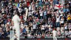 England's Jos Buttler celebrates his half century as fans applaud. Photograph: Paul Childs/Inpho