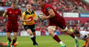 Munster's Tommy O'Donnell runs in a try. Photograph: Tommy Dickson/Inpho