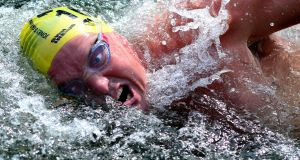 A swimmer  in the men's race during the annual LIffey Swim. Photograph: Cyril Byrne