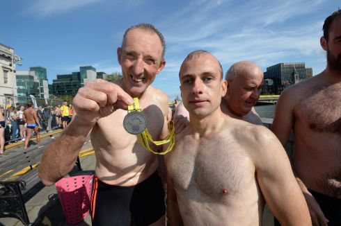 David Tilly holding the  medal he won,  with  blind swimmer  Donnacha Mc Carthy from  Markievicz Swimming Club, in  the Liffey  swim. Photograph: Cyril Byrne