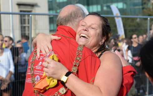 Debbie Gould gets a hug from the Lord Mayor of Dublin, Nial Ring, after the the Jones Engineering 99th Dublin City Liffey Swim. Photograph: Dara Mac Donaill