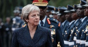 Theresa May reviews a military guard of honour at the State House in Nairobi on August 30th. Photograph: Asuyoshi Chiba/AFP/Getty Images