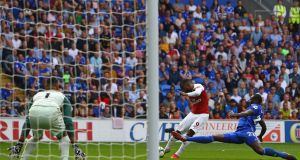 Alexandre Lacazette scores Arsenal's winner against Cardiff. Photograph: Geoff Caddick/AFP