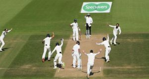 Moeen Ali takes the crucial wicket of India captain Virat Kohli at Southampton. Photograph: Stu Forster/Getty