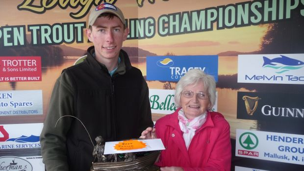 Rosemary Maguire presenting the Denis Maguire Memorial Trophy to junior winner Brendan Heaney at Melvin Open.