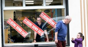 Jim Gartlan looks out the window of his shop, which closed on Friday. Photograph: Brian Farrell