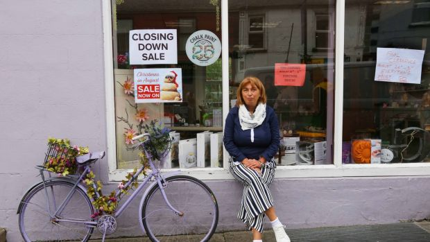 Nicoletta Pantano sits outside her shop, Scented Meadows, which closed on Friday. Photograph: Brian Farrell