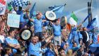 Dublin fans celebrate as their team defeat Tyrone at Croke Park to make it four All-Irelands in a row.  Photograph: Dara Mac Dónaill
