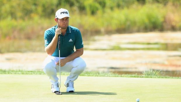 Hatton lines up a putt on the second green. Photo: Andrew Redington/Getty Images