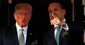 Simon Coveney said he didn't see any inconsistency in him tweeting about US policy in the Middle East and then welcoming the decision by the US president to come to Ireland. Above, Donald Trump with Taoiseach  Leo Varadkar at the St Patrick's Day reception  in Washington,  earlier this year. Photograph:  Jonathan Ernst/Reuters
