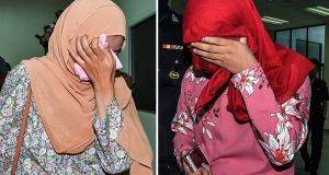 A composite image shows two women who were each caned six times  after they pleaded guilty at the Sharia High Court to homosexual activity in the state of Terengganu, Malaysia. Photograph: Stringer/EPA
