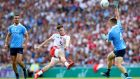 Tyrone's Connor McAliskey shoots past Eoin Murchan of Dublin during the All-Ireland SFC final at Croke Park. Photo: James Crombie/Inpho