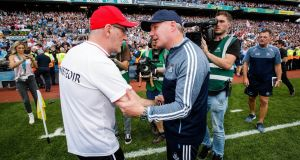 Tyrone manager Mickey Harte shakes hands with Dublin's Jim Gavin at the end of the All-Ireland SFC final. Photo: Ryan Byrne/Inpho