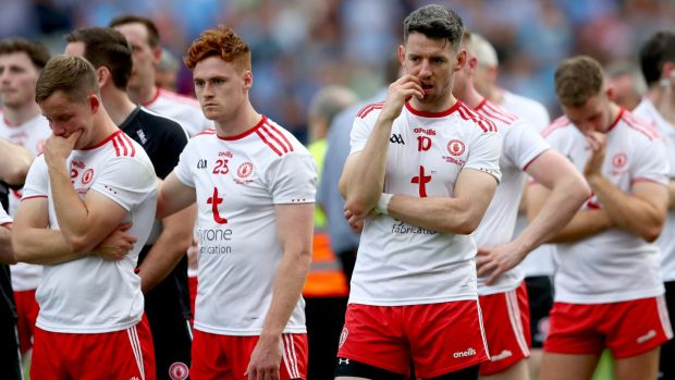 Despondent Tyrone captain Mattie Donnelly and his fellow players following the All-Ireland final defeat to Dublin at Croke Park. Photograph: James Crombie/Inpho