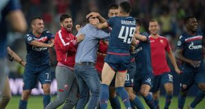 Red Star Belgrade's coach Vladan Milojevic celebrates with his team after they beat Red Bull Salzburg to qualify for the Champions League group stages. Photo: Getty Images