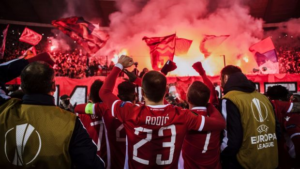 Red Star players celebrate with their fans after beating FC Cologne in the Europa League last year. Photo: Nikola Krstic/Action Plus via Getty Images