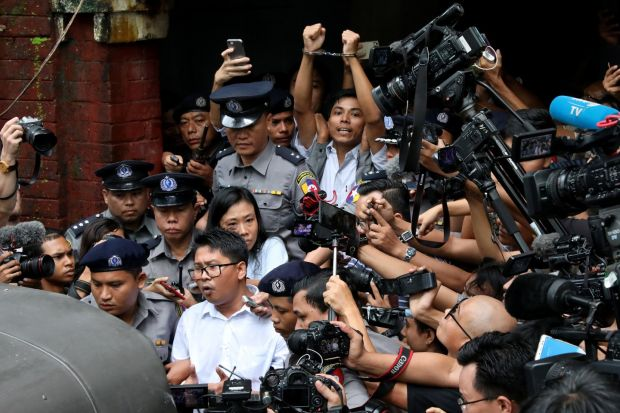 PRESS CLAMPDOWN: Reuters journalists Wa Lone and Kyaw Soe Oo (both in white shirts) leave Insein court after being jailed for seven years in Yangon, Myanmar, for illegal possession of official documents. They had been attempting to report on an alleged massacre of Rohingya Muslims by members of the Myanmar military. Photograph: Reuters