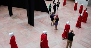 "Women dressed as characters from ""The Handmaid's Tale"" walk through the Hart Senate Office Building as supreme court nominee Brett Kavanaugh starts the first day of his confirmation hearing. Photograph: Jim Watson/AFP/Getty Images"