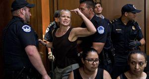 A demonstrator is removed by US Capitol police during a  confirmation hearing for supreme court nominee Brett Kavanaugh. Photograph: Andrew Harrer/Bloomberg