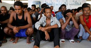 Migrants in a shelter who were relocated from government-run detention centres after being trapped by clashes between rival groups in Tripoli, Libya. Photograph: Hani Amara/Reuters