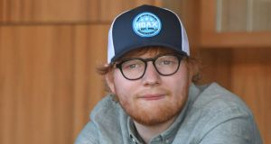 "Ed Sheeran: Viagogo claims the singer's promoter ""forced  fans to buy new tickets, pocketing millions of pounds in duplicate sales"". Photograph:  Vince Caligiuri/Getty"