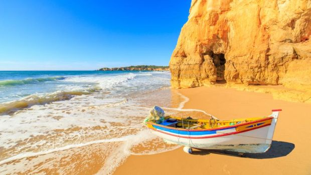 Portugal: the Algarve has dramatic cliffs and golden sandy beaches. Photograph: Getty