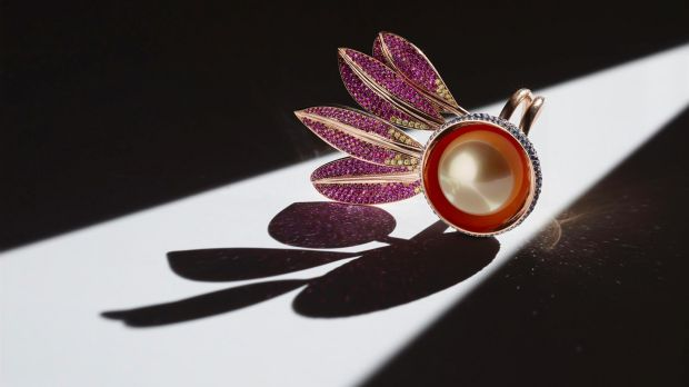 Seed Takes Flight - golden south sea pearl with 931 individually set gemstones - sapphires, yellow diamonds, rubies and tsavorite garnets.