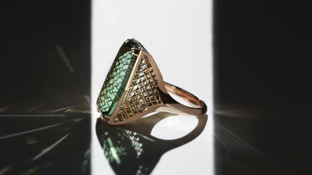 Labyrinth - green tourmaline with diamonds set underneath in 18ct yellow gold