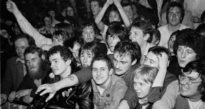 Fans watch  Gang Of Four perform live on stage during the Rock Against Racism Red Rhino tour, at West Runton in  England, on  March 20th, 1979. Photograph: Virginia Turbett/Redferns
