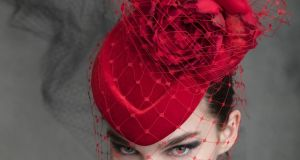 Red pillbox with silk chiffon rose and veiling by Philip Treacy at the Design Centre, Powerscourt.