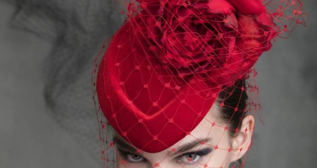 bbe0ed4c99c Red pillbox with silk chiffon rose and veiling by Philip Treacy at the  Design Centre
