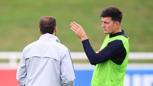 Harry Maguire tries to explain the Uefa Nations League to England manager Gareth Southgate. Photograph: Laurence Griffiths/Getty
