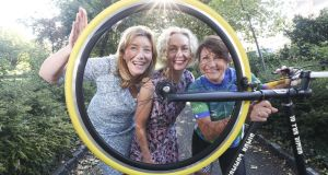 On hand to wish cyclist Joanne Hession, right,   a safe journey were, from left, Mary Rose Burke  and Anne O'Leary, all from the Dublin Chamber of Commerce. Photograph: Conor McCabe