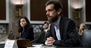 Twitter chief Jack Dorsey speaks as chief operating officer of Facebook  Sheryl Sandberg listens during a Senate Intelligence Committee hearing in Washington, DC. Photograph: Andrew Harrer/Bloomberg