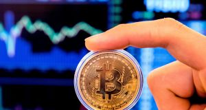 Bitcoin tumbled as much as 9.8 per cent and was trading at $6,422 as of 1:25pm in Hong Kong, according to Bloomberg composite pricing. Photograph: Jack Guez/AFP/Getty Images