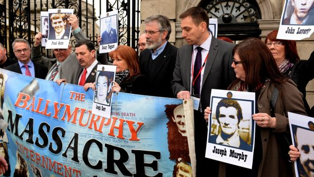 Former Sinn Féin leader Gerry Adams with solicitor Pádraig Ó Muirigh and relatives of the Ballymurphy victims on January 30th, 2014. Photograph: Cyril Byrne